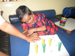 Therapie aan kind met beperking